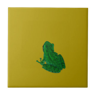 Green colorzed frog against yellow look up small square tile
