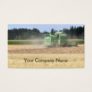 Green combine harvester cutting crops business card