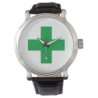 green cross symbol wrist watch