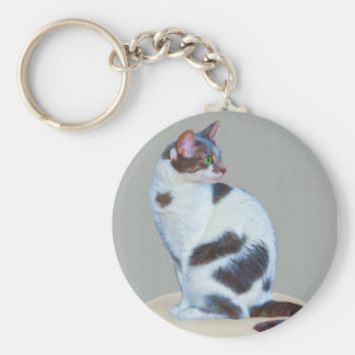 Green-eyed Cat on a Mat Keychain