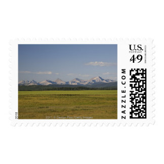 Green Fields And Rolling Hills With Mountains Postage