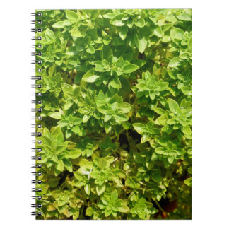 green foliage background plant spiral notebook