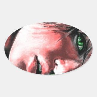 green framed  green eyed beauty oval sticker