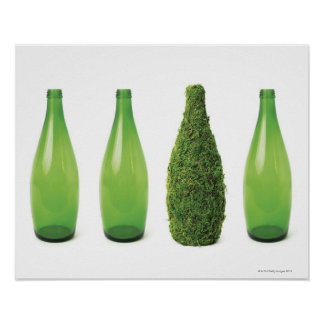 Green glass bottles showing recycling and poster