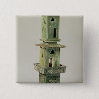 Green glazed model of a tower pinback button