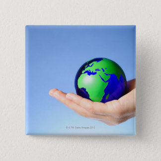 Green globe in hand pinback button