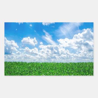 Green grass and blue sky rectangular sticker