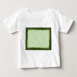 Green grass border on light green baby T-Shirt