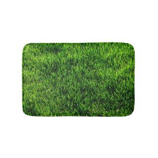 Green grass texture from a soccer field bath mat
