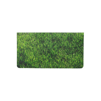 Green grass texture from a soccer field checkbook cover