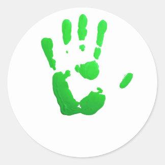Green hand-print classic round sticker