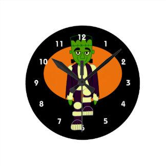 Green head monster orange behind round wall clocks
