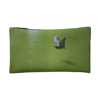 Green Heron In Mid Air Cosmetics Bags