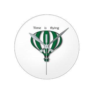 Green hot air balloon with a slogan round clock