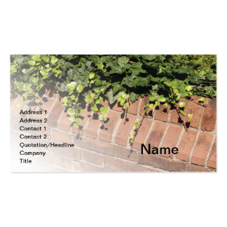 green ivy by a red brick wall business card