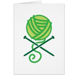 Green knitting wool and crossbones needles card