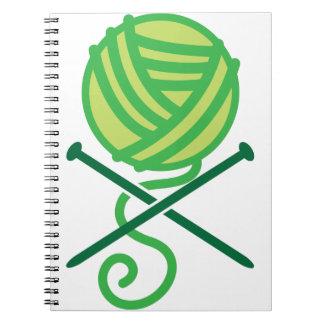 Green knitting wool and crossbones needles notebook