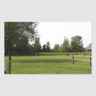 Green Lawn with Wood Fence and Trees Rectangular Sticker