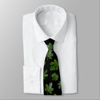 Green leaf closeup isolated on black background neck tie