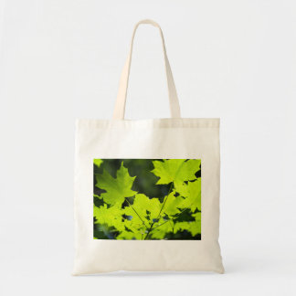 Green leaves in the woods tote bag