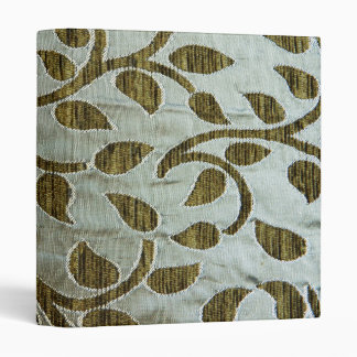 Green leaves on silvery fabric binder