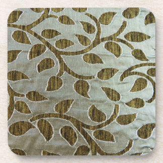 Green leaves on silvery fabric drink coaster