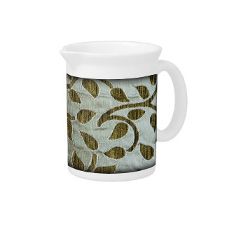 Green leaves on silvery fabric pitchers