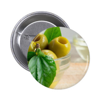 Green marinated olives pitted in a glass cup button