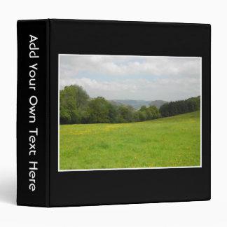 Green meadow. Countryside scenery. Binder