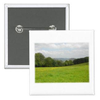 Green meadow. Countryside scenery. Custom Button