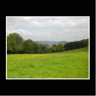 Green meadow. Countryside scenery. Statuette