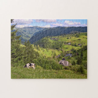 Green Meadows and a cow with panorama view Jigsaw Puzzle