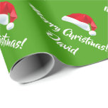 "Green Merry Christmas Santa Hat wrapping paper<br><div class=""desc"">Green Merry Christmas Santa Hat wrapping paper. Customize Name or Wordings. Perfect for Christmas or Holiday gift-wrapping and crafting. For further customization,  please click the ""Customize it"" button and use our design tool to modify this template.</div>"