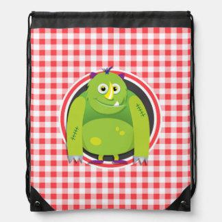 Green Monster on Red and White Gingham Drawstring Backpacks