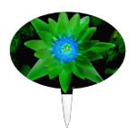 green neat water lily flower against green leaves cake topper