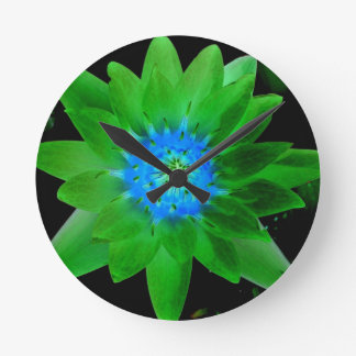 green neat water lily flower against green leaves round wall clocks