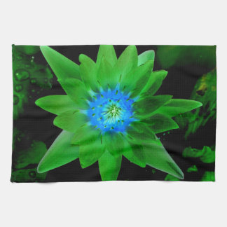 green neat water lily flower against green leaves kitchen towel