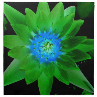 green neat water lily flower against green leaves cloth napkin