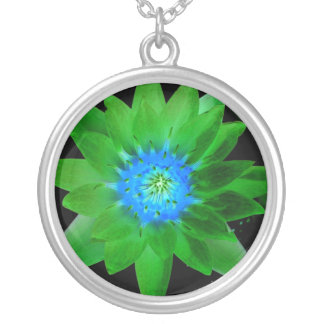 green neat water lily flower against green leaves round pendant necklace