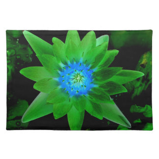 green neat water lily flower against green leaves place mat