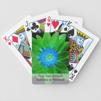 green neat water lily flower against green leaves poker deck