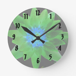 green neat water lily flower against green leaves round clock