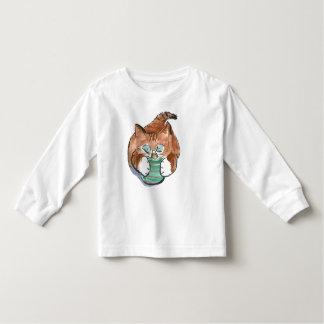 green ornament matches kitten's eyes toddler t-shirt