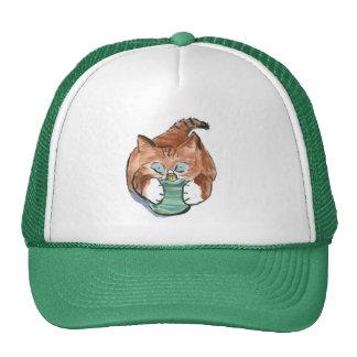 green ornament matches kitten's eyes trucker hat
