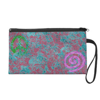 Green peace sign with pink and teal pattern wristlet purse