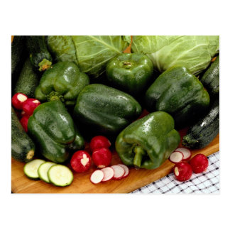 Green peppers, zucchini, cabbage on a cutting boar post cards