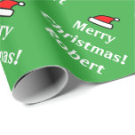 "Green personalized Merry Christmas wrapping paper<br><div class=""desc"">Personalized name green Santa Claus hat Christmas wrapping paper. Personalizable giftwrap text for custom seasons greetings and name of child. Customizable background color and text for your Holiday wishes or funny note. Surprise your friends and family during the Holidays. Cute custom Santa Clause hat design for xmas party favors and...</div>"