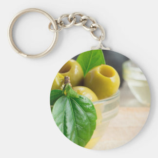 Green pickled pitted olives closeup keychain