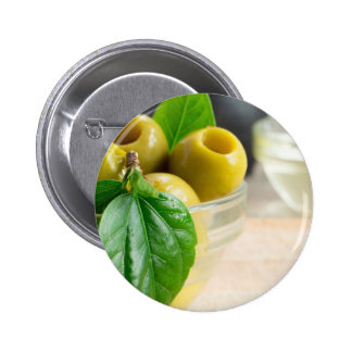 Green pickled pitted olives closeup pinback button