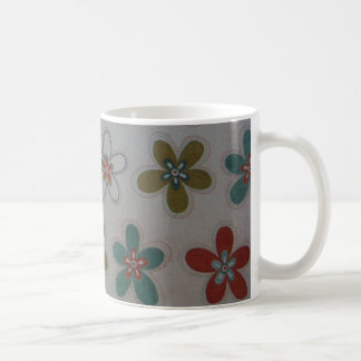 Green pink and blue floral pattern coffee mug